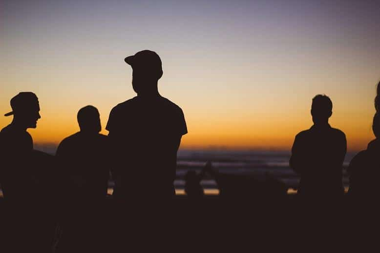 A group of shadowed people silhouettes