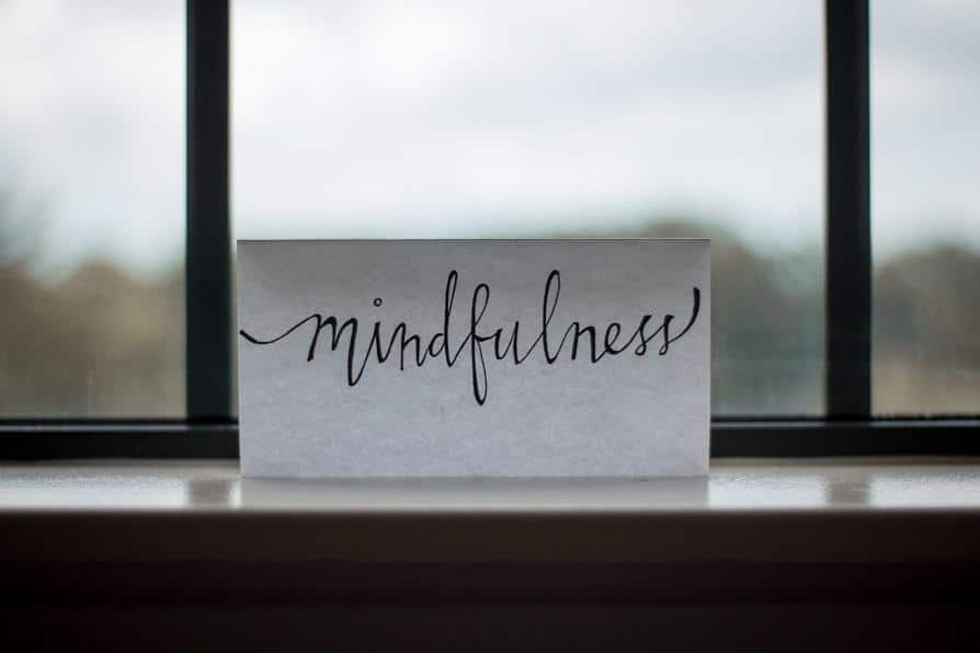 """The writing """"mindfulness"""" on the paper that's on the peaceful windowsill."""